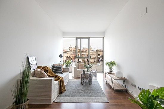 A Home BCN with Cubiqz cardboard couch and chair with off white fabric cover