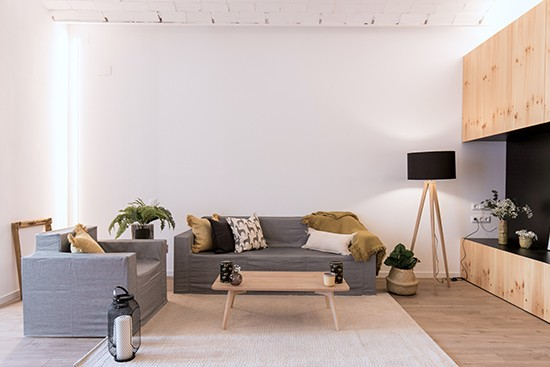 A Home BCN with Cubiqz cardboard couch and chair with Grace fabric cover